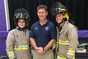 Students in firefighters uniform Canaan